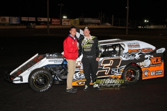 Andy Tiernan stands in Victory Lane at Boone Speedway following his win in the IMCA Northern SportMods during the 2013 Frostbuster on Saturday, April 6.