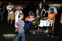 Kids look over their creations during the cardboard car races at Boone Speedway on Saturday, August 10, 2013.