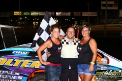 Cale Sponsler stands in the IMCA Modified victory lane at Boone Speedway on Saturday, August 6, 2011.