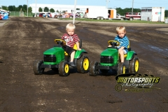 Young fans take practice for a future in farming the track at Boone Speedway on Saturday, July 2, 2011.