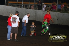 Young fans race down the track at Boone Speedway on Saturday, July 2, 2011.