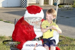 Kids got a special visit from Santa during Christmas in July on Saturday, July 20, 2013, at Boone Speedway.