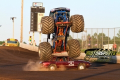 A monster truck takes aim on its next victim, a late model sedan, at Boone Speedway on Monday, July 4, 2011.