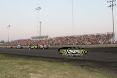 IMCA Modifieds race down the front stretch during fan appreciation night at Boone Speedway on Saturday, July 6, 2013.