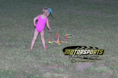 This young fan enjoyed the ring toss game during fan appreciation night at Boone Speedway on Saturday, July 6, 2013.