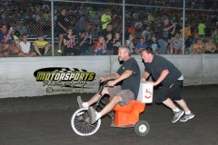 Fans cheer on the toilet bowl drivers during fan appreciation night at Boone Speedway on Saturday, July 6, 2013.