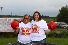 Participants of Boone's giant beer pong tournament strike a pose on Saturday, June 1.