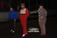 Drivers show off their new footwear during the Diva Dash at Boone Speedway on Satuday, May 11, 2013. The good sported drivers wore high heels in a foot race to see who was the fastest off the track.