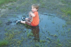 A young fan splashes in the only puddle to be found at Boone Speedway on Saturday, May 21, 2011.