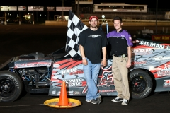 Josh Gilman stands in victory lane on Saturday, May 28, 2011, after leading the IMCA modifieds to the checkers.