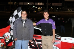 Charlie Brown stands in Victory Lane for the MADCRA Dwarf Car division feature at Boone Speedway on Saturday, May 7, 2011.