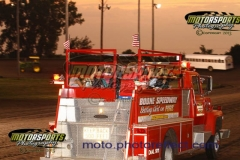 They're 'Setting the Dirt on Fire' with a trip around the track on the Boone Speedway firetruck.