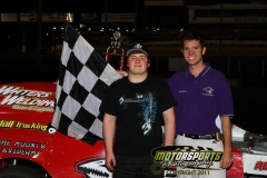 Joel Bushore stands in the Modified Victory Lane on Saturday, June 4, 2011, at Boone Speedway.