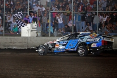richie-gustin-flashes-under-the-double-checkers-to-take-is-first-imca-modified-supernationals-victory