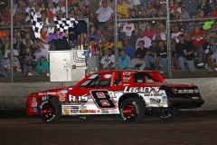 sean-johnson-flashes-under-the-checkerd-flags-winning-the-imca-stock-car-supernationals-feature-for-2011