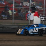 Andy Hennigar takes the checkers in the MADCRA Dwarf division at Boone Speedway on Saturday, April 16, 2011.