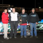 Eric Elliott of the IMCA Northern SportMod class stands in victory lane on Saturday, April 16, 2011, at Boone Speedway.