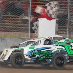 Colby Oberembt takes the checkers at Boone Speedway on Saturday, May 14, 2011, in the MADCRA Dwarf Car division.