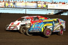 jimmy-gustin-moves-inside-of-jay-matthias-de-pere-wis-as-he-made-his-way-to-lead-and-winning-the-imca-modified-race-of-champions-at-the-boone-speedway
