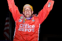 sean-johnson-leaps-for-joy-after-winning-the-stock-car-feature-at-the-supernationals